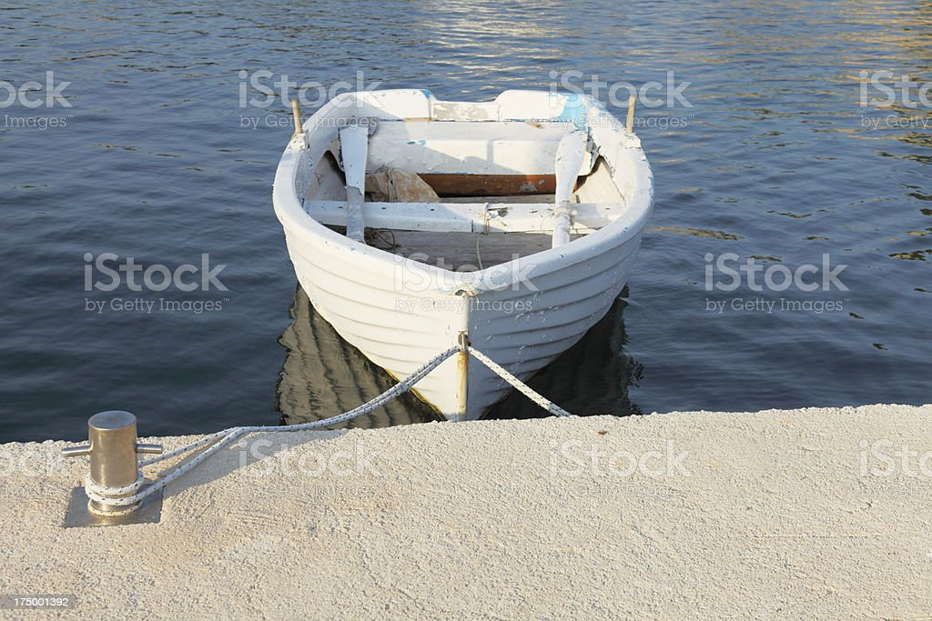 turquoise blue mediterranean ocean and white row boat Croatia royalty-free stock photo