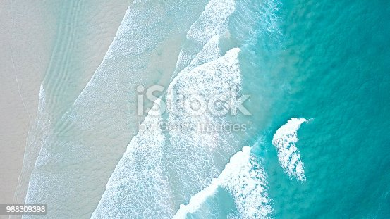 istock Turquoise blue ocean water white wash crashing on shoreline sand beach drone aerial from above 968309398