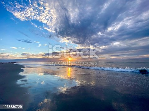 istock Turquoise blue water color filled cloudy sunrise 1278830729