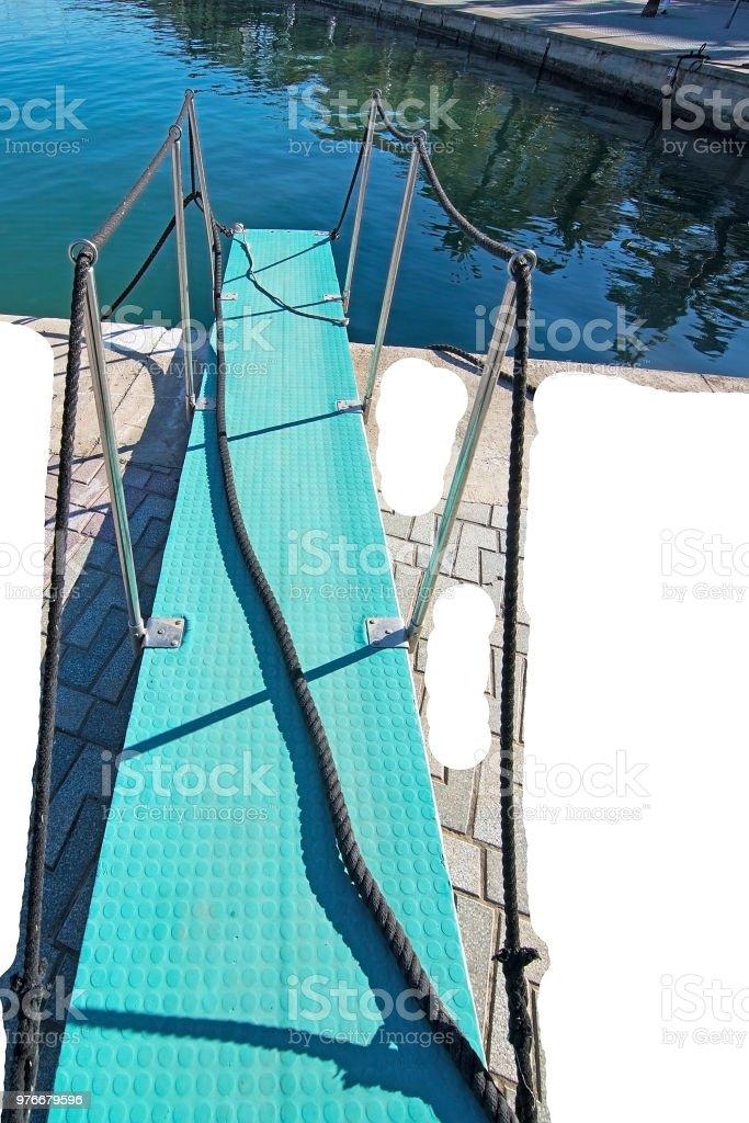 Turquoise board bridge marine detail isolated on white stock photo