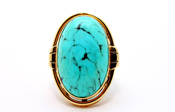 Turquoise Brooch with Gold Setting  on White Background stock photo