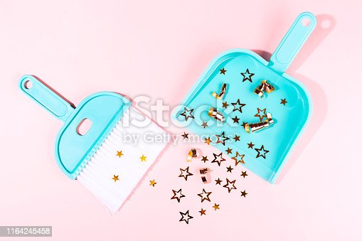istock Turquoise broom and dustpan on pastel pink background. 1164245458