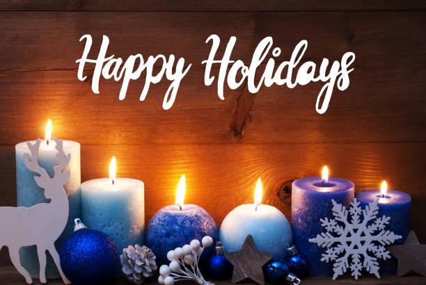 Türkis Kerze, Weihnachtsdekoration, Text Happy Holidays – Foto