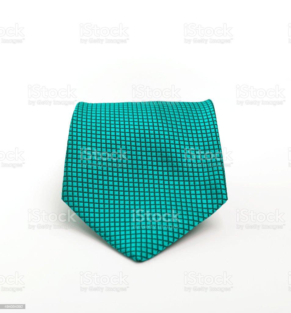 Turquoise color necktie on white background stock photo