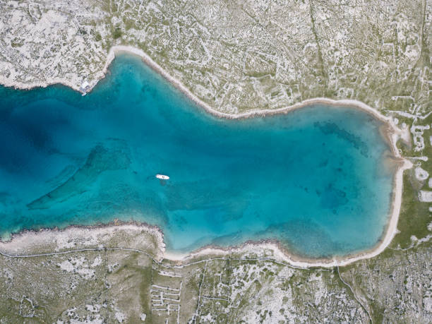 Turquoise colored bay from above stock photo