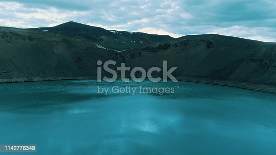 Aerial view of vibrant colored water in crater lake