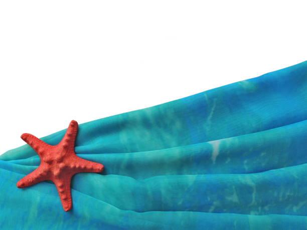 turquoise folded pareo beach with a red starfish - schal mit sternen stock-fotos und bilder
