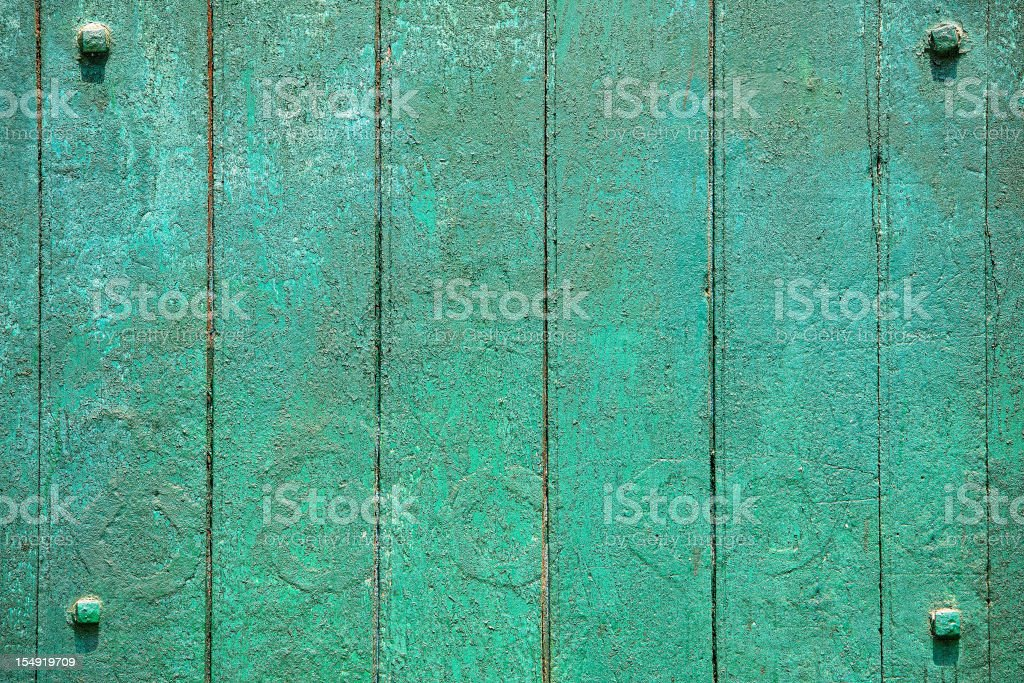 Turquoise grunge wood background with four framing studs. royalty-free stock photo