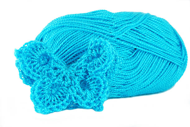 turquoise hand crochet butterfly stock photo