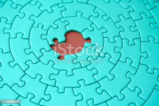 istock turquoise jigsaw with one missing piece 115888971