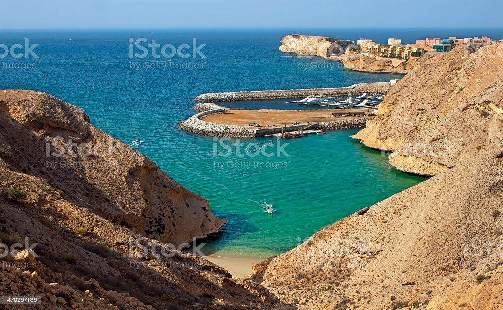 Turquoise Lagoon Oman Coast with hidden beautiful beach stock photo