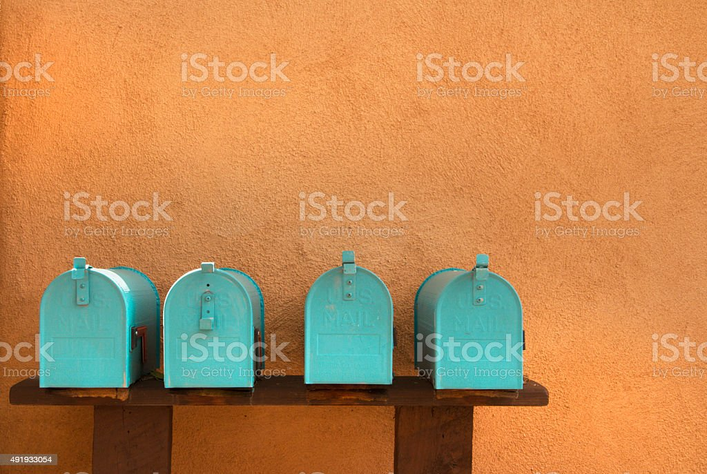 Turquoise Mailboxes and Stucco Adobe, Santa Fe New Mexico Style stock photo