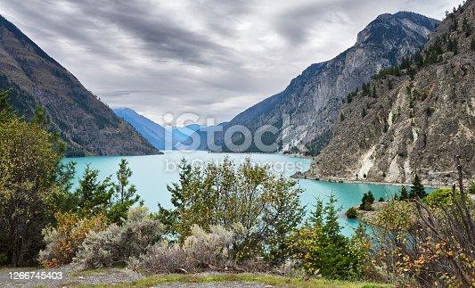 istock Turquoise mountain Seton Lake between mountain ranges. 1266745403