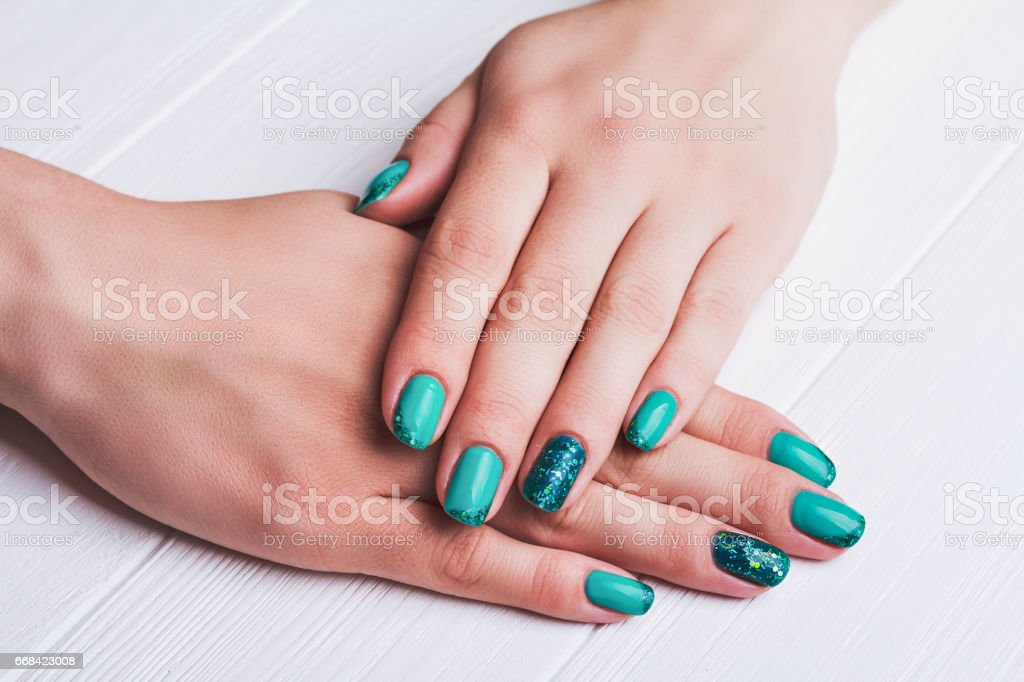 Turquoise Nail Art With Tinsels stock photo   iStock