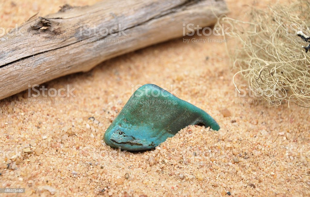 Turquoise on beach stock photo