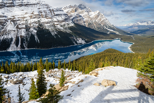 Vibrant Blue Peyto Lake with reflection of Canadian Rocky Mountain, a glacier-fed lake in Banff National Park in Alberta, Canada. Seen from Bow Summit