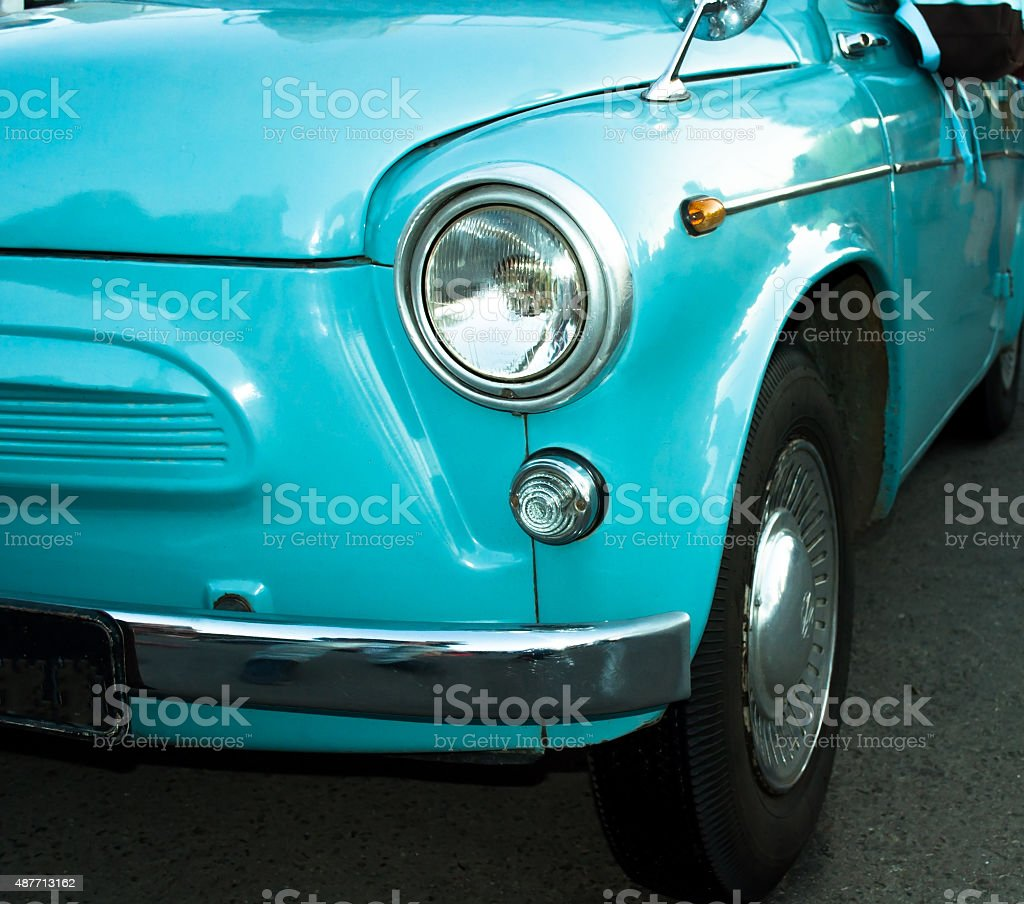 Turquoise retro car close up view stock photo