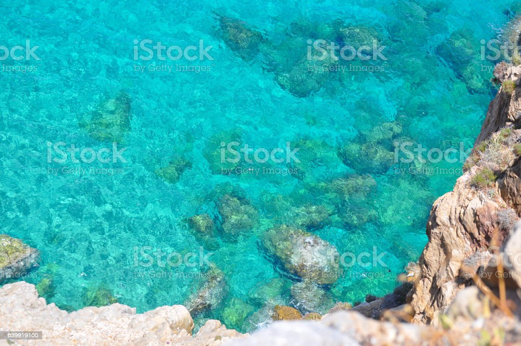 turquoise sea and rocks stock photo