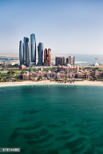 517465184 istock photo Turquoise sea and skyscrapers in Abu Dhabi 518144362