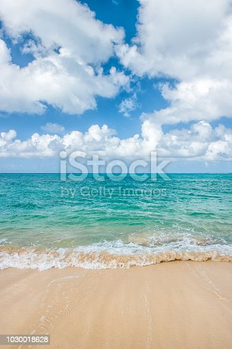 Turquoise sea and perfect blue sky with white clouds. Summer travel background