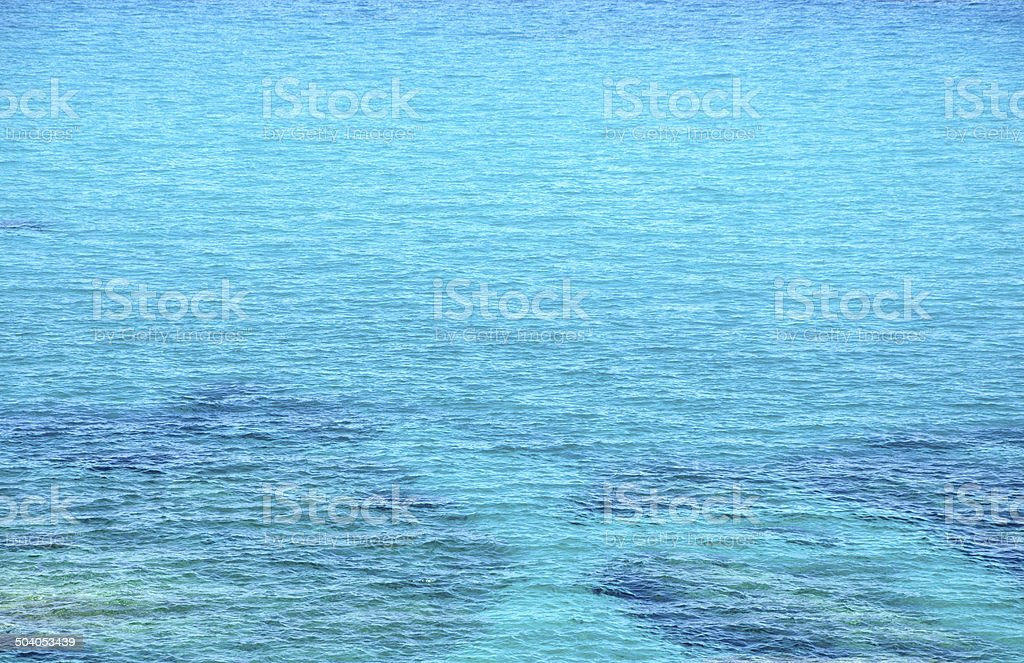 Turquoise sea surface with small waves stock photo