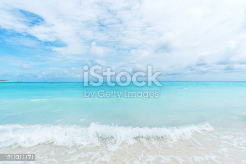 Turquoise sea wave comes to shore