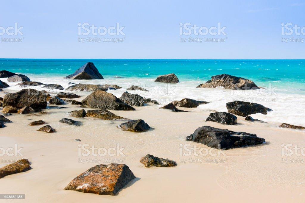 turquoise sea white sand and rocky under sunshine very beautiful nature at Bai nhat beach Condao island stock photo