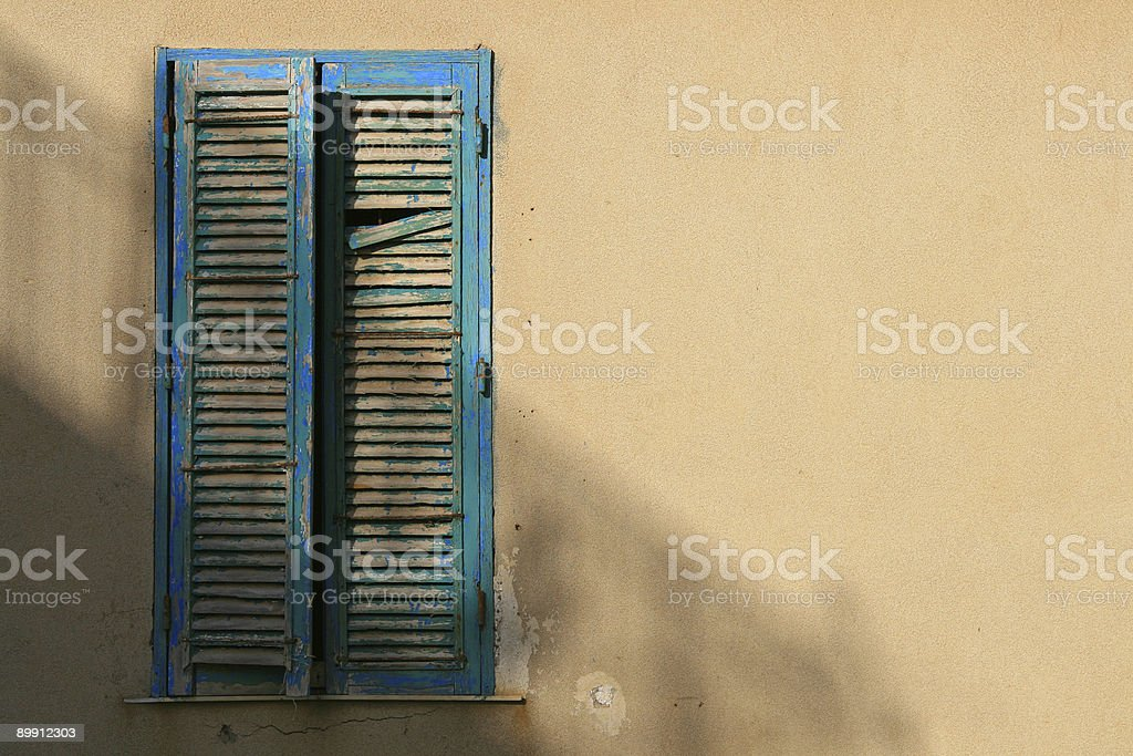 Turquoise shutters in Italy royalty-free stock photo