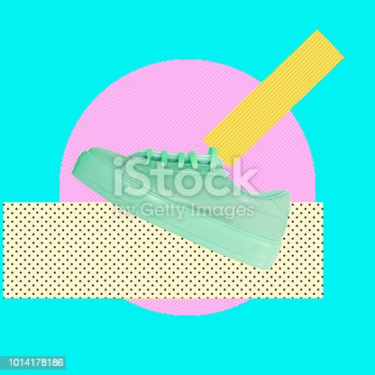 1014178164 istock photo Turquoise sneaker on a pink circle and traces of paint. 1014178186