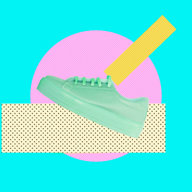 Turquoise sneaker on a pink circle and traces of paint. stock photo