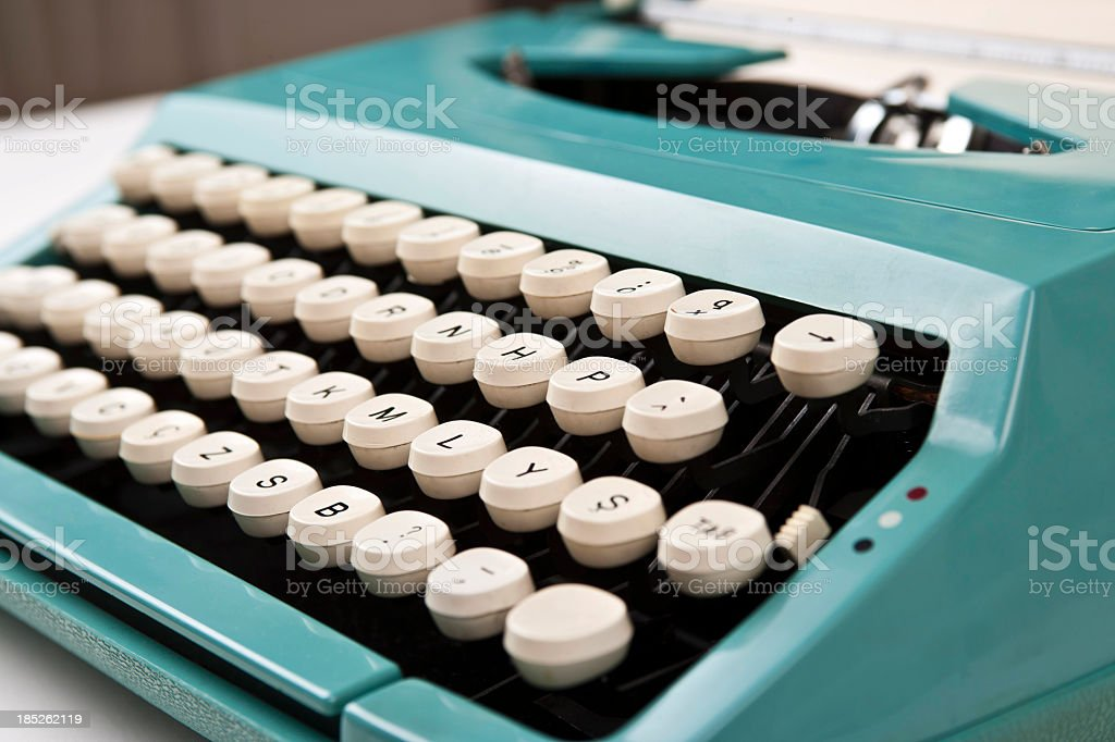A turquoise vintage typewriter royalty-free stock photo