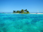 Beautiful turquoise colored water near an idyllic island, barrier reef in Belize, Central America, Caribbean.