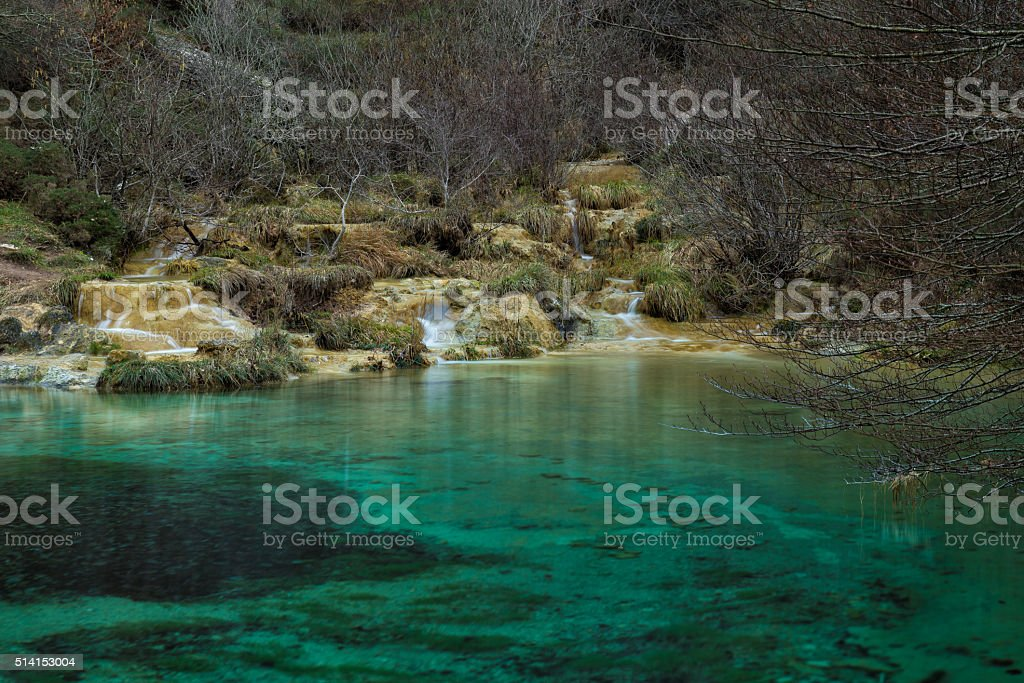 Turquoise water in Covalagua waterfalls stock photo