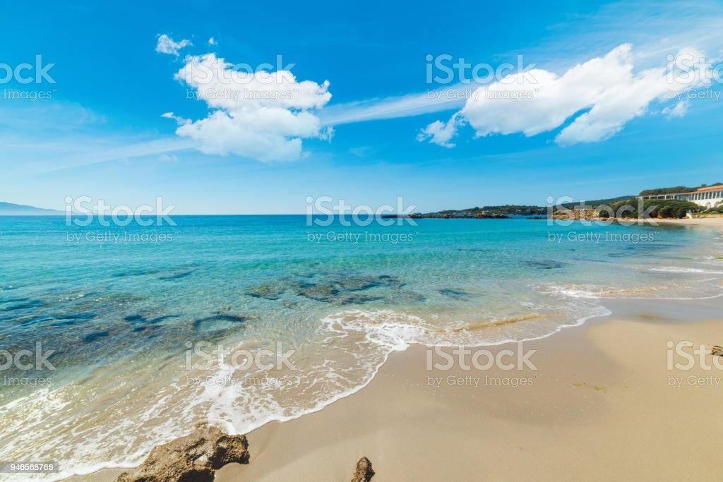 Turquoise water in Le Bombarde beach in Alghero stock photo
