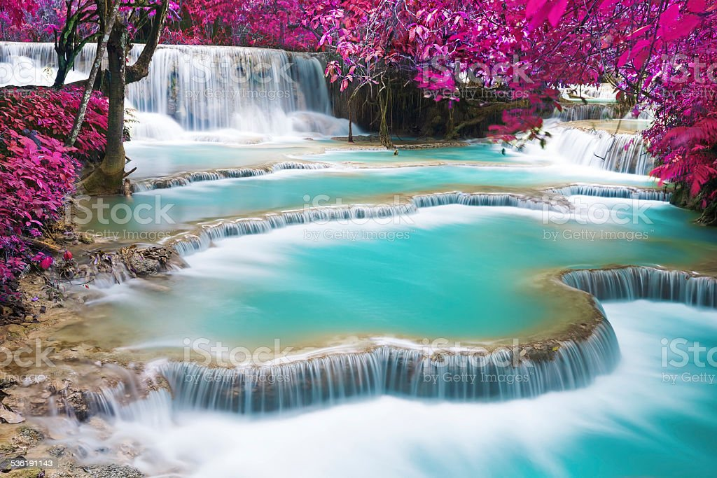 Turquoise water of Kuang Si waterfall stock photo