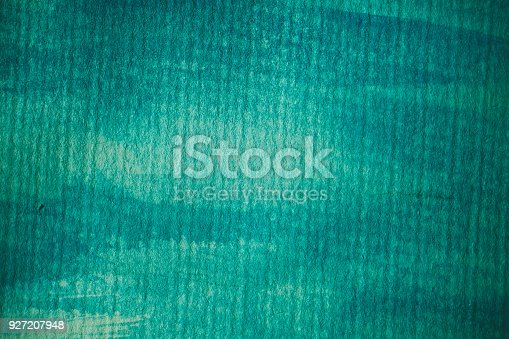 istock Turquoise watercolor background. Turquoise abstract texture and background for design. Turquoise  watercolor background on textured paper. Closeup of hand painted background. 927207948