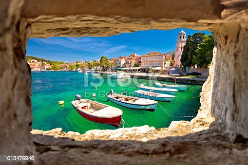 Turquoise waterfront of Cavtat view through stone window, Dalmatia, Croatia