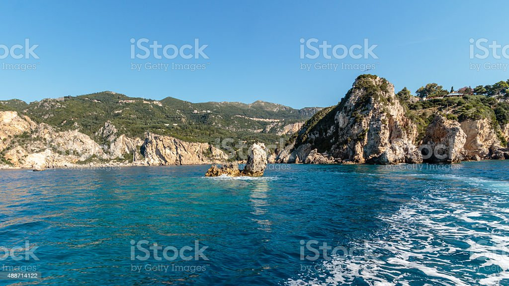 Turquoise waters, cliffs on western shore of Corfu, Greece stock photo