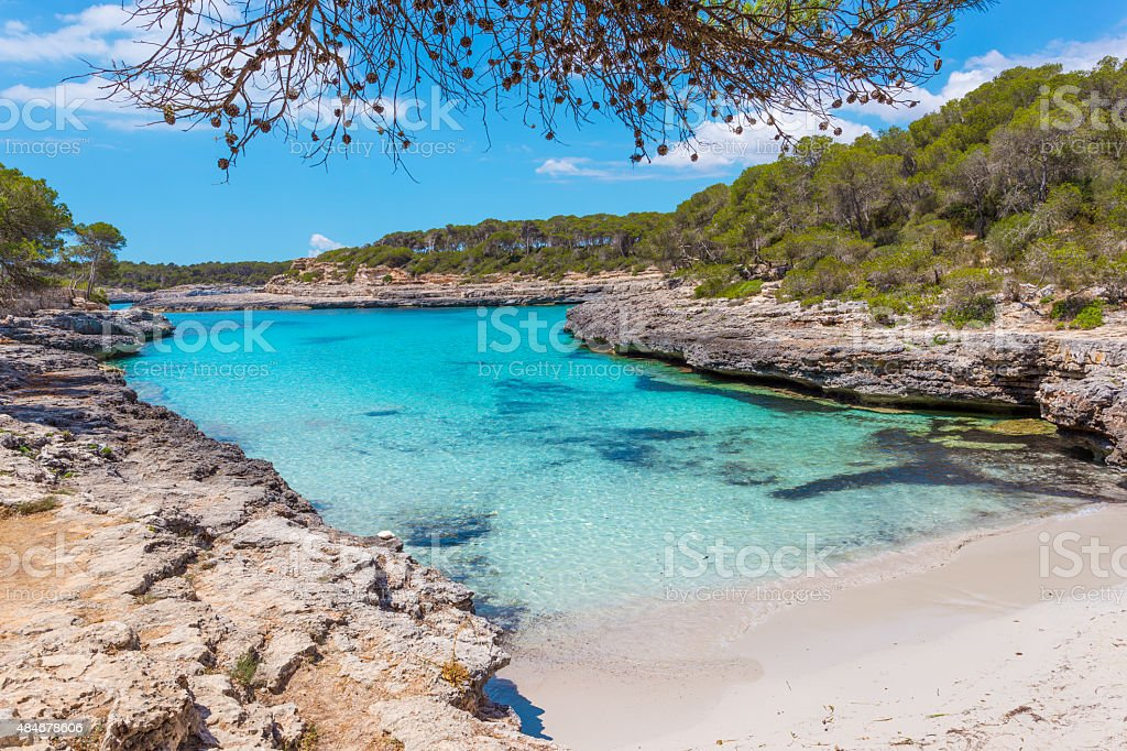 Turquoise waters of a bay in the Mondrago Natural Park stock photo