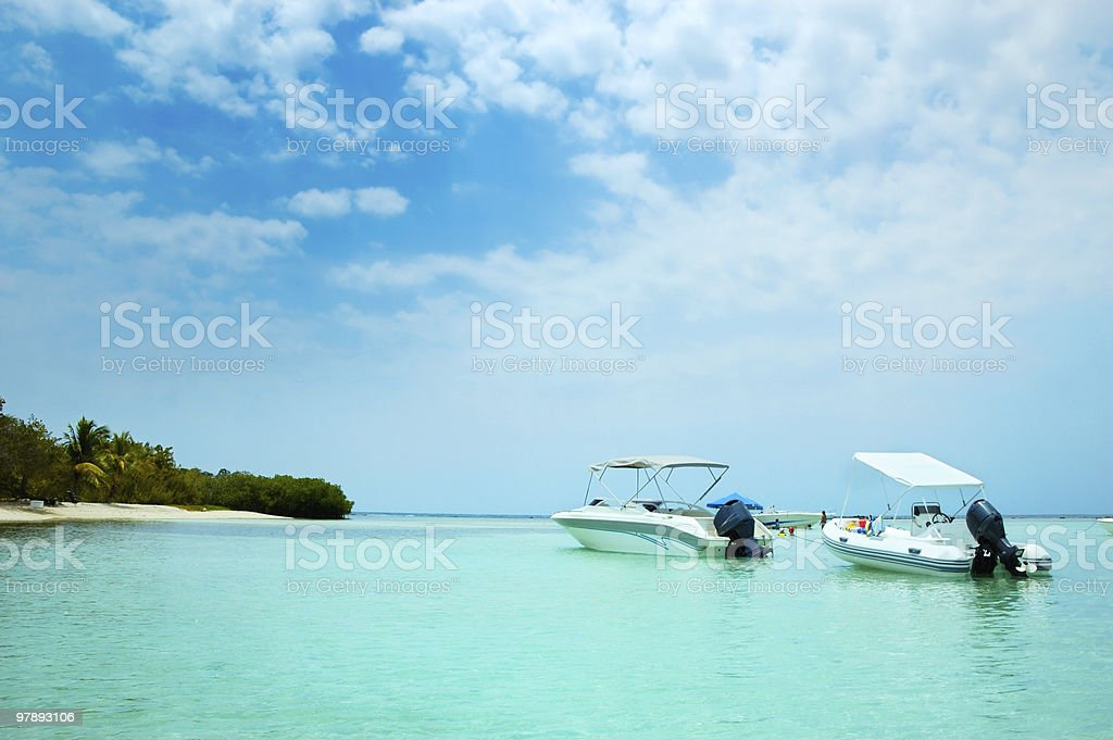 Turquoise waters of a white sand Tropical island beach royalty-free stock photo