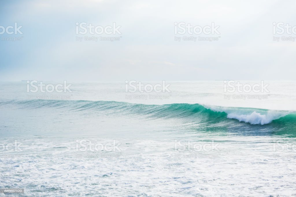 Turquoise wave in ocean and Sun rays royalty-free stock photo