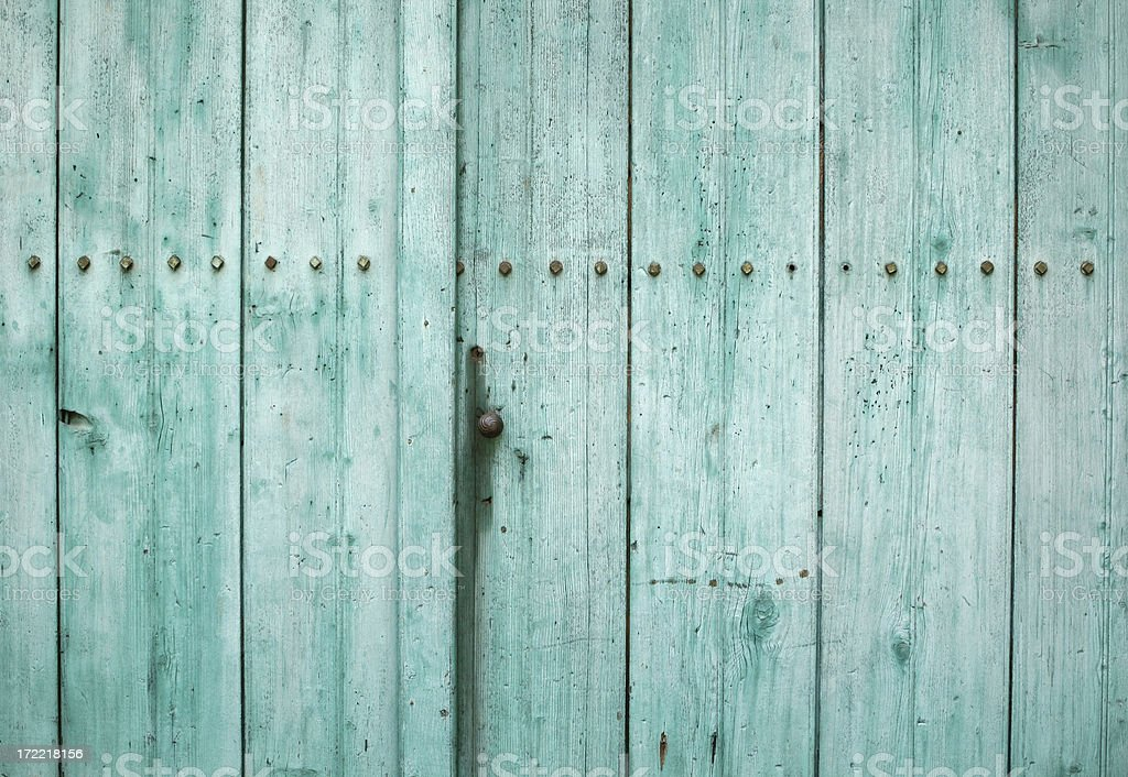Turquoise weathered wooden door texture 2 royalty-free stock photo