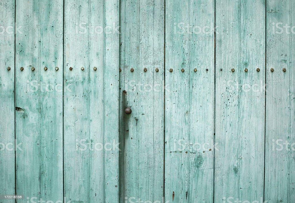 Turquoise weathered wooden door texture 2 stock photo