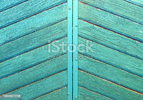 1178501072istockphoto turquoise wooden pannels backgroubg. Retro gate background. 1054927228