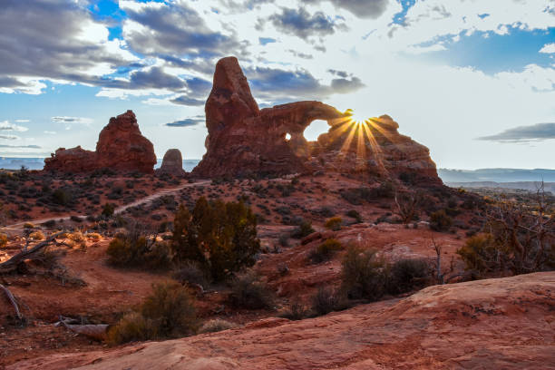 Turret Arch Sunset Our local star setting over Turret Arch in Arches National Park, Utah. American Southwest. navajo sandstone formations stock pictures, royalty-free photos & images