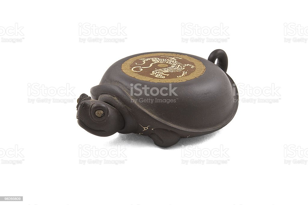 turtle-shaped stand for ceramic teapot royalty-free stock photo
