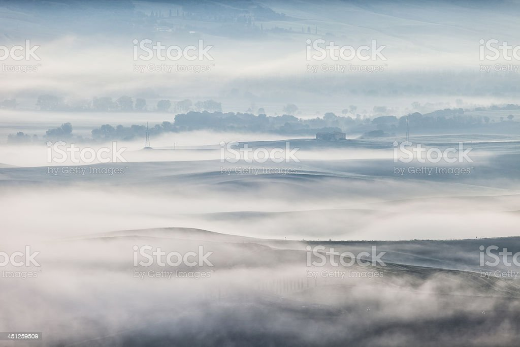 Tuscan Landscape Covered With Morning Mist royalty-free stock photo