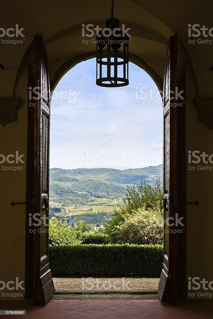 Tuscan Landscape through Open Door, Chianti Region in Italy stock photo