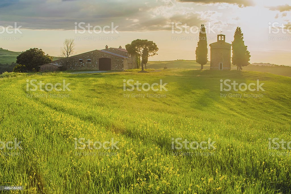 Tuscan landscape with a chapel at sunset royalty-free stock photo