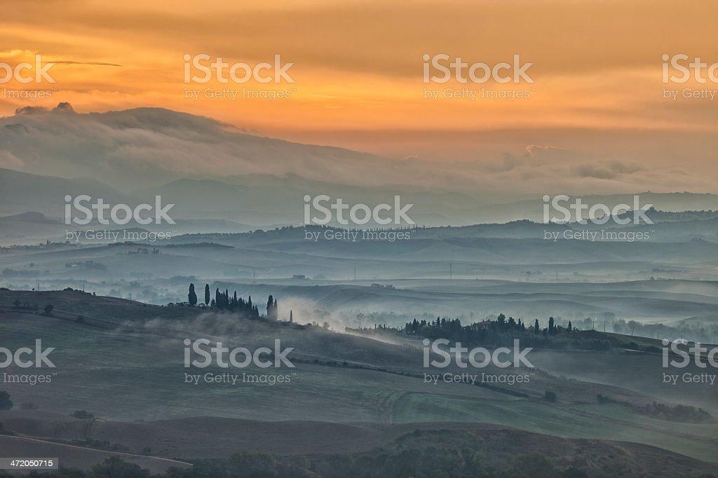 Tuscan Landscape With Fog at Sunrise royalty-free stock photo